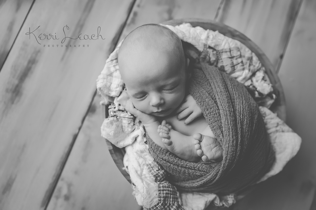 Kerri Leach Photography-Evansville IN newborn photographer-Newborn Photographer Evansville-newborn pose flow-newborn wrapping