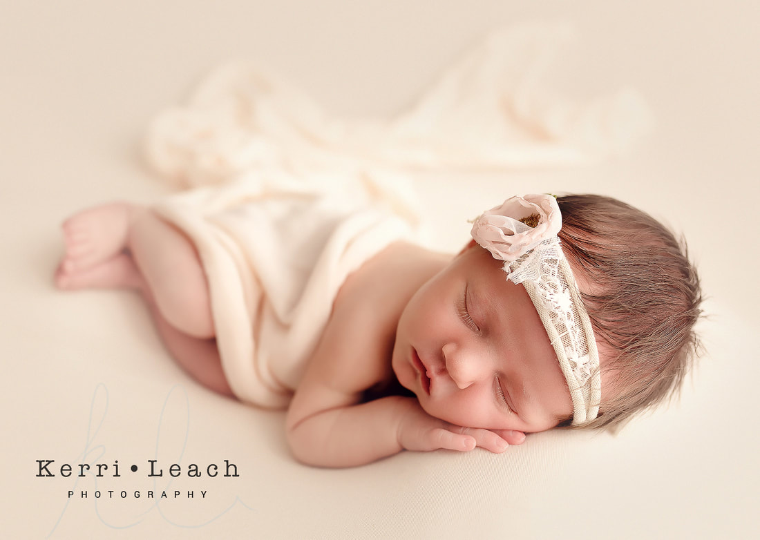 Evansville, IN Newborn photographer | Newborn photography bean bag poses | Newborn photography | Newburgh, IN newborn photography studio | Photography studio Newburgh, IN